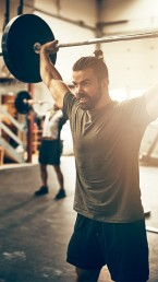 CrossFit class with barbells